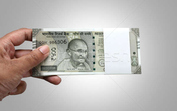 Indian Currency Rupee 500 Bank Note Bundle in a Hand Stock photo © Akhilesh
