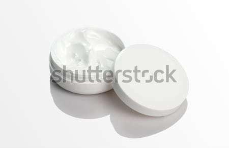 Blank Cosmetic Cream Pack Mockup on white reflective background Stock photo © Akhilesh
