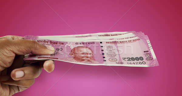 New Indian Rupee 2000 Currency Note in a Hand Stock photo © Akhilesh