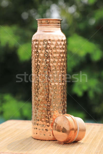 Hammered Copper Water Bottle for Good Health Stock photo © Akhilesh