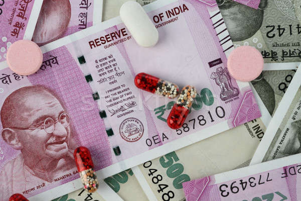 New Indian Rupee Bank Notes with Medicines / Pills Stock photo © Akhilesh