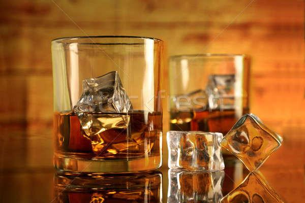 Rum / Whiskey Glasses with Ice Cubes Stock photo © Akhilesh