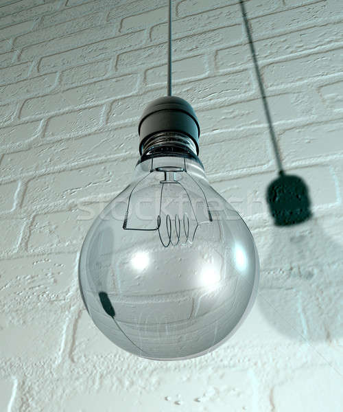 Hanging Light Bulb And Fitting On A Wall Stock photo © albund