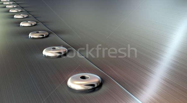 Rivets On Brushed Metal Perspective Stock photo © albund