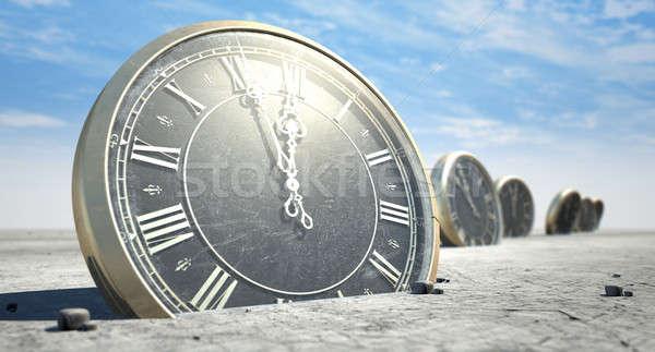 Antique Clocks In Desert Sand Stock photo © albund
