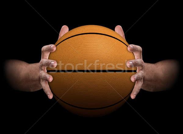 Hands Gripping Basketball Stock photo © albund