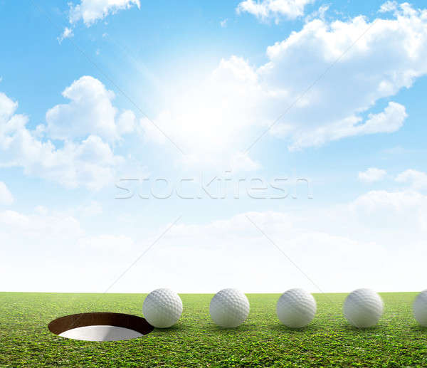Golf Hole And Ball Putt Path Stock photo © albund