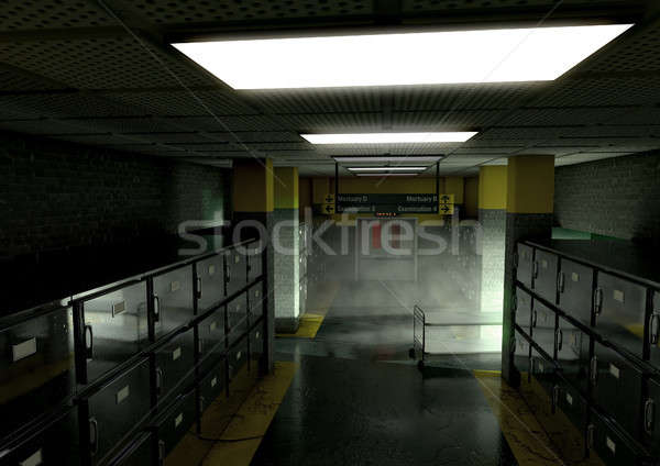 A look down the aisle of fridges of a dimly lit ward in a mortuary with an empty gerney in the dista Stock photo © albund