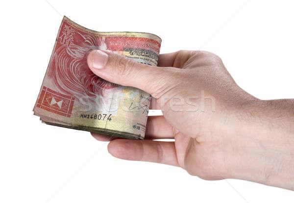 Hand Passing Wad Of Cash Stock photo © albund