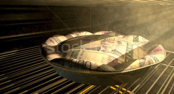 Norwegian Kronor Money Pie Baking In The Oven Stock photo © albund