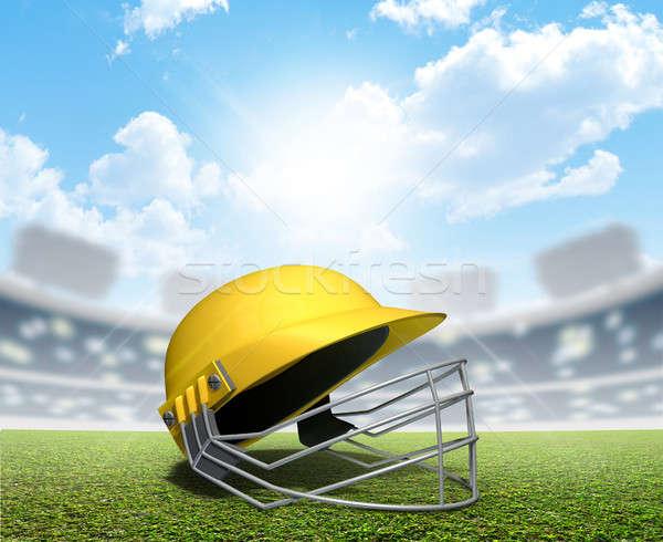 Stock photo: Cricket Stadium And Helmet