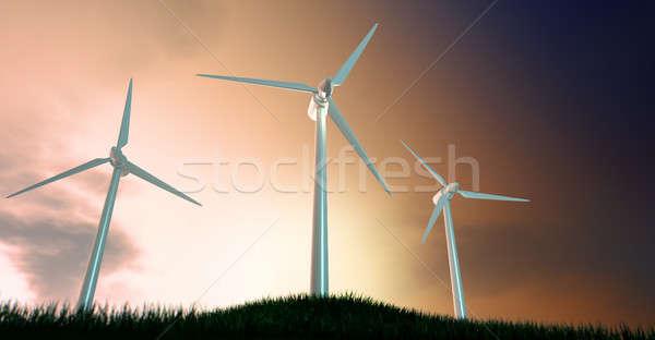 Wind Turbines On Grassy Hill At Dawn Stock photo © albund