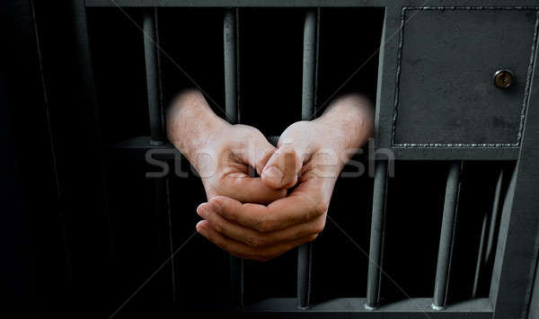 Jail Cell Door And Hands Stock photo © albund