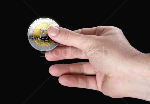 Main bitcoin Homme or argent Photo stock © albund