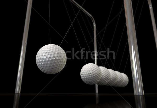 Golf Ball On A Newtons Cradle Stock photo © albund