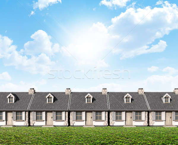 Row Of Cottages On Green Lawn Stock photo © albund