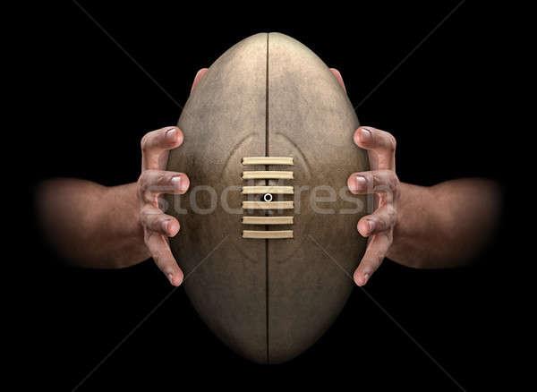 Mains préhension ballon de rugby paire Homme vintage Photo stock © albund