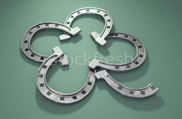 Afortunado herradura trébol cuatro verde metal Foto stock © albund
