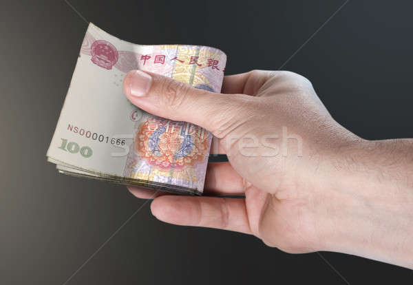 Hand Passing Wad Of Cash Stock photo © albund