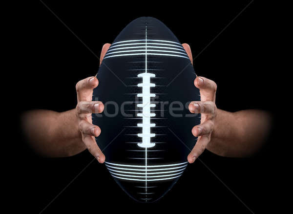 Hands Gripping Football Stock photo © albund