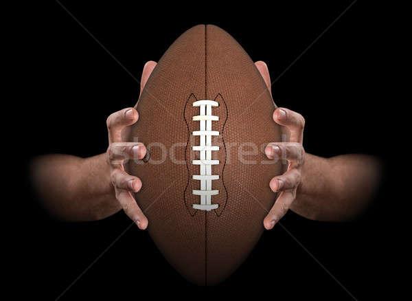 Hands Gripping Football Stock photo © albund