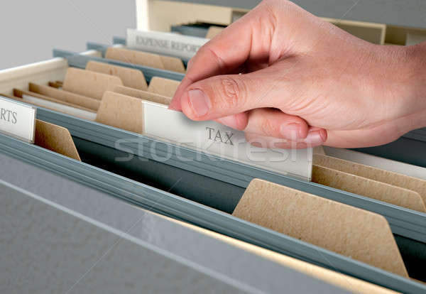 Hand Looking Though Filing Cabinet Drawer Stock photo © albund
