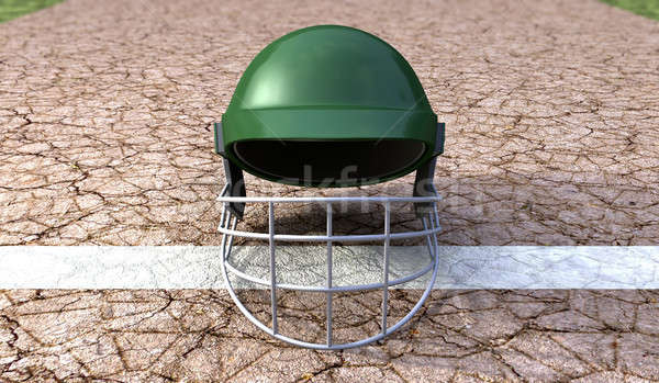 Cricket Helmet On Cracket Pitch Front Stock photo © albund