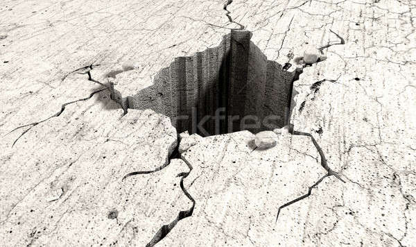 Hole In The Cracked Ground Perspective Stock photo © albund