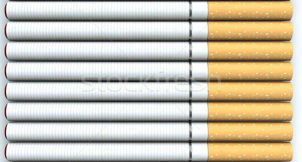 A close up of a laid out collection of regular electronic cigarettes with a glowing red tip on an is Stock photo © albund