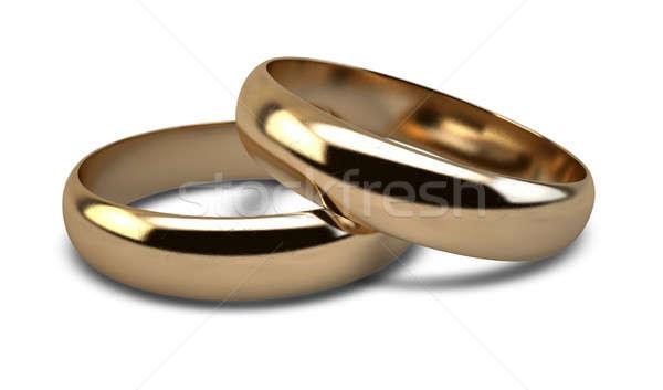 Jegygyűrű arany pár jegygyűrűk pihen izolált Stock fotó © albund