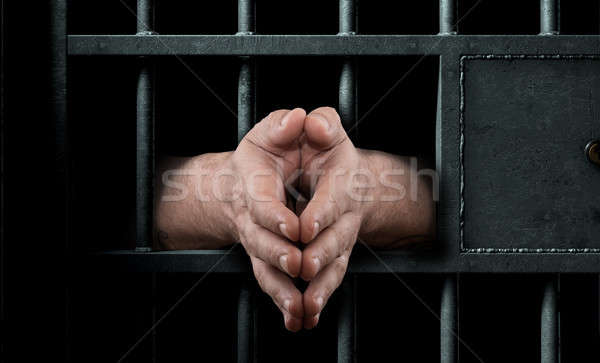 Cella di prigione porta mani primo piano carcere Foto d'archivio © albund