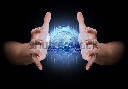 Hands Grasping Cryptocurrency Stock photo © albund