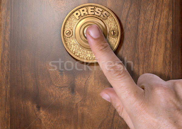 Finger Pressing Doorbell Stock photo © albund