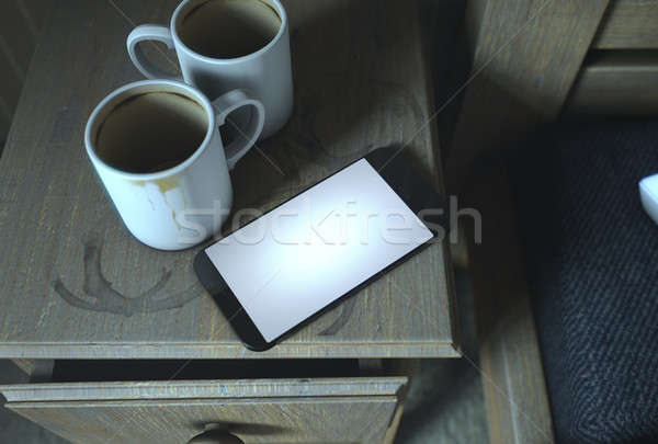Bedside Table And Cellphone Stock photo © albund