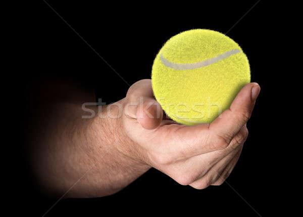 Hand tennisbal mannelijke geïsoleerd donkere Stockfoto © albund