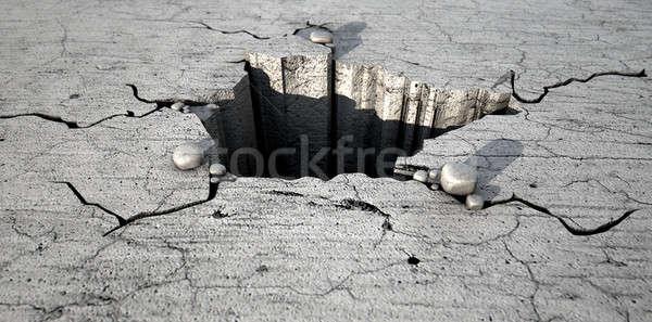 Hole In The Cracked Ground Stock photo © albund