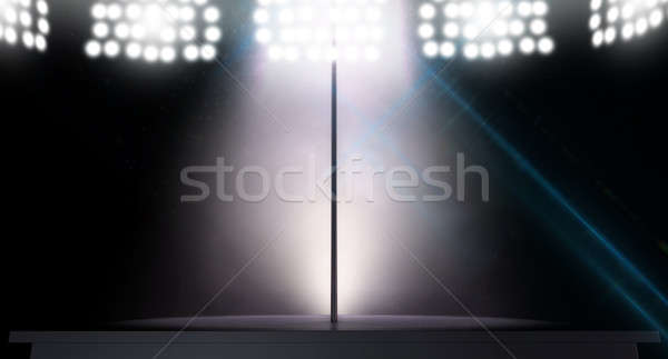 An isolated stripper pole on a stage lit by a single pink spotlight on a dark background Stock photo © albund