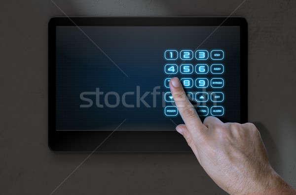 Hand Pressing Modern Home Security Stock photo © albund