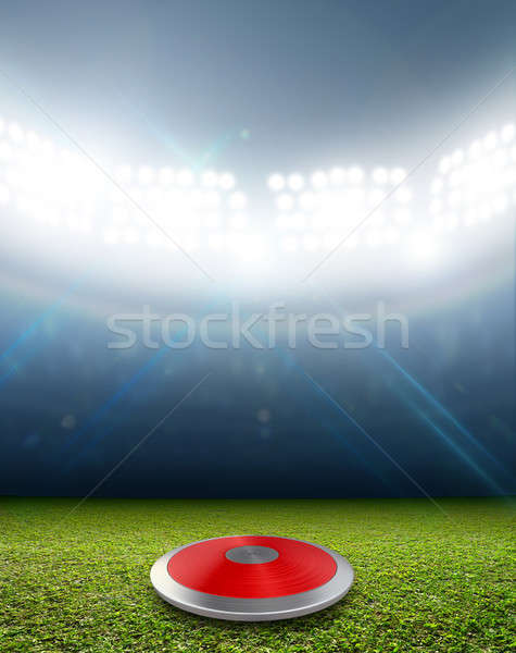 Discus In Generic Floodlit Stadium Stock photo © albund