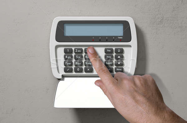 Hand Pressing Home Security System Stock photo © albund