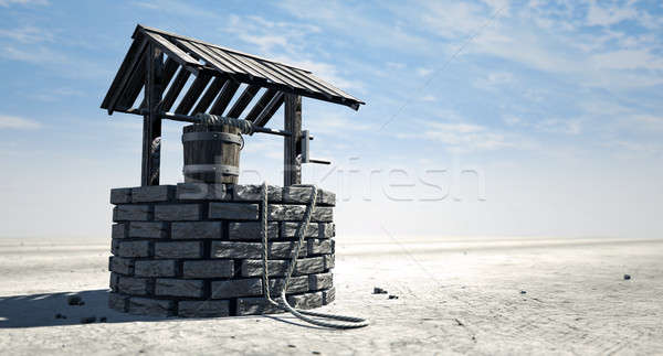Wishing Well With Wooden Bucket On A Barren Landscape Stock photo © albund