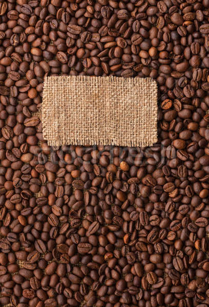 Tag made of burlap lies against the backdrop of  coffee beans Stock photo © alekleks