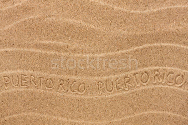 Puerto Rico inscription on the wavy sand Stock photo © alekleks