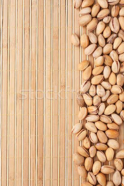 pistachios  lying on a bamboo mat  Stock photo © alekleks