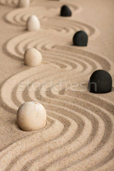 line black and white  stones, standing on the sand Stock photo © alekleks