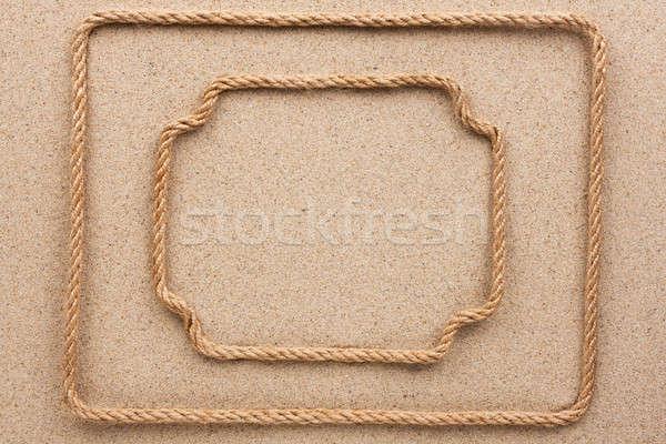 Two frame made of rope lying on the sand Stock photo © alekleks