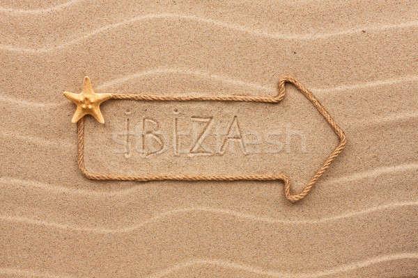 Arrow made of rope and sea shells with the word Ibiza on the san Stock photo © alekleks