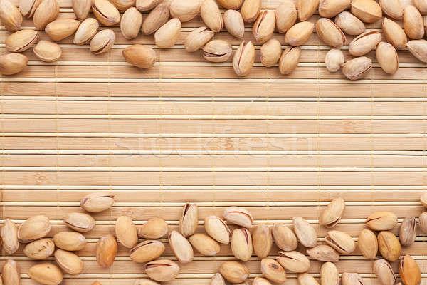 Pistachios  lies on the a bamboo mat Stock photo © alekleks