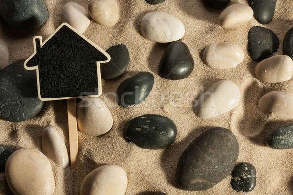 Pierres maison sur sable soleil Photo stock © alekleks
