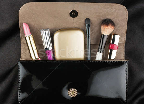 Black patent leather bag  with cosmetics Stock photo © alekleks